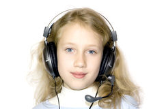 Young girl and headset Stock Image