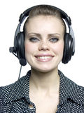 Young girl  with a headset. Beautiful smiling attractive young girl  with a headset Stock Photos