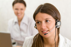 Young girl with headset in the office Stock Photography