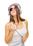 Young girl hear music by headphones Stock Photos