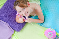 Young girl hearing surprising news Stock Photography