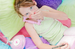 Young girl hearing surprising news Royalty Free Stock Images