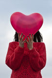 Young girl with heart balloon Stock Photo