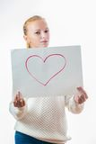 Young girl with the heart on the sheet of paper stock photography