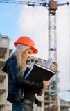 Young girl in a helmet before building Stock Photos