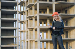 Young girl in a helmet before building Stock Image