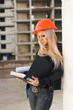 Young girl in a helmet before building Royalty Free Stock Photography