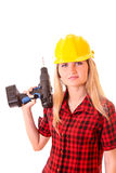 Young girl in helmet with drill isolated Stock Photography