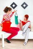Young girl helping choose clothes girlfriend. Young girl helping choose clothes her girlfriend royalty free stock images
