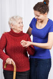 Young girl helping senior woman Royalty Free Stock Photography