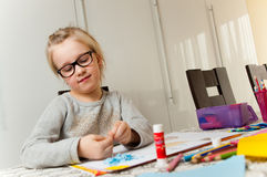 Young Girl and Her Art Project stock image