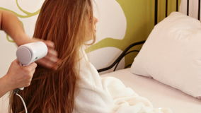 Young girl during her beauty routine stock footage