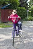 Young girl with her bicycle Royalty Free Stock Image