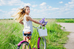 Young girl with her bike outdoors Stock Image