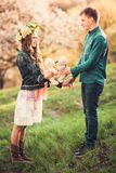 Young girl and her boyfriend holding two teddy bears Royalty Free Stock Image