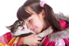Young girl and her cat Stock Images