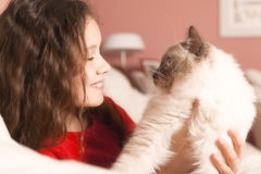 Young girl with her cat Stock Photo
