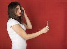 Young girl with her cell phone Royalty Free Stock Photos