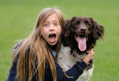 Young girl with her dog Royalty Free Stock Image