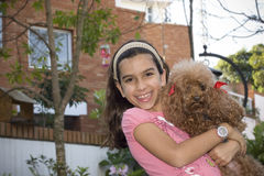 Young girl and her dog. Happy girl holds her pet dog Stock Photos