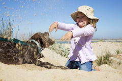 Young girl and her dog. A beautiful young girl playing with her german pointer puppy on the beach Stock Photo