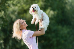 Young girl with her dog. Portrait of a young girl with her dog Royalty Free Stock Photo
