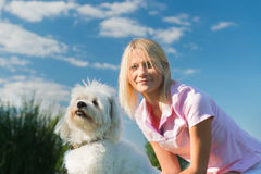 Young girl with her dog Stock Image