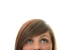 Young girl with her eyes looking away up Royalty Free Stock Image