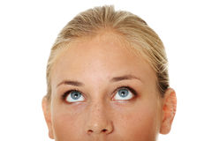 Young girl with her eyes looking up Stock Photo