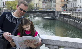 Young girl and her father studying a city map Stock Photo