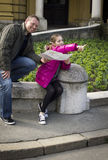Young girl and her father studying a city map Royalty Free Stock Images