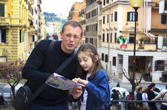 Tourist in rome with city map Stock Photography