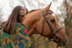 Young girl and her horse. Young girl communicating with her horse Royalty Free Stock Images