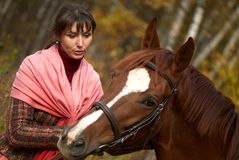 Young girl and her horse. Young beautiful girl and her horse Stock Images