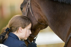 Young girl and her horse stock photography