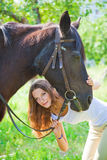 Young girl with her horse. Royalty Free Stock Photos