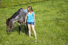 Young girl and her horse Royalty Free Stock Images