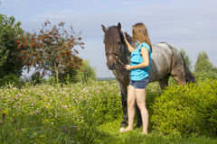 Young girl and her horse Stock Photos