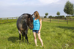 Young girl and her horse Royalty Free Stock Photo