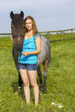 Young girl and her horse Royalty Free Stock Photography