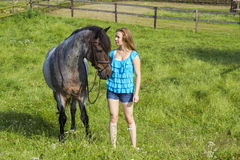 Young girl and her horse Royalty Free Stock Image