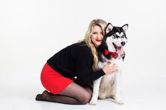 Young girl with her husky dog  on white Royalty Free Stock Photo