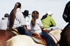 Young girl and her mother on horses. Mother and daughter watching the action at a rodeo Royalty Free Stock Photography
