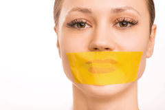 Young girl with her mouth taped Stock Photography