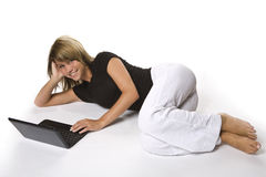 A young girl and her netbook Stock Photo