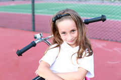 Young girl and her new bike Royalty Free Stock Image