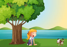 A young girl and her pet near the tree royalty free illustration
