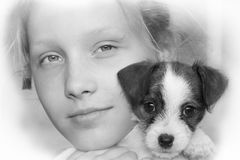 Young girl and her puppy Royalty Free Stock Photography