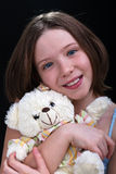 Young girl with her teddy bear Stock Photos