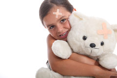 Young girl and her teddy bear Stock Images